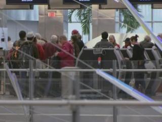 Passengers use ticket kiosks at Raleigh-Durham International Airport.