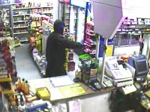 The Franklin County Sheriff's Office is offering a $2,000 reward for help identifying a gunman suspected in at least five armed robberies in recent weeks.