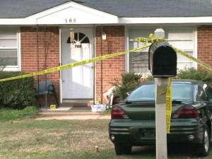 Crime scene tape surrounds 708 Colonial Drive on Jan. 7, 2012, two days after Jose Samual Flores Mendoza and his wife, Maria Saravia Mendoza, were fatally shot in their home.