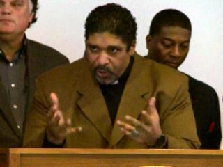 State NAACP President William Barber, center, addresses a Jan. 15, 2013, gathering at the Legislative Building in Raleigh, urging N.C. lawmakers to address poverty issues.