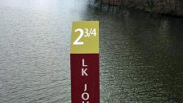 A new mile marker along the greenway trail by Lake Johnson. Photo by James Borden for Raleigh Public Record