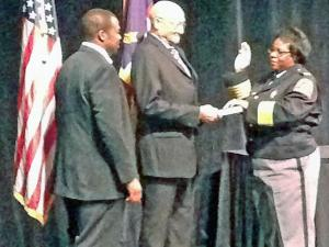 Cassandra Deck-Brown was sworn in Friday morning as Raleigh's new police chief. Her father, Joseph Deck Jr., held the Bible while her son, David Brown, pinned her uniform.