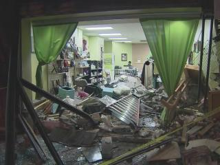 Owners of the Hairizon Beauty Oasis have a mess to clean up after an SUV crashed into the business early Monday.