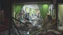 IMAGES: Vehicle crashes into store, wrecks 'American dream'