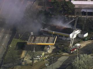 Smoke billows from the roof of a north Raleigh convenience store.