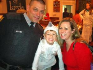Trooper Michael L. Potts with his wife and son