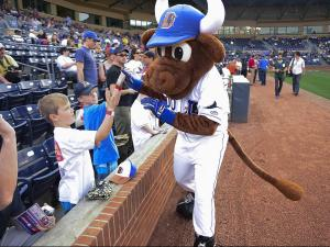 Wool E. Bull high fives a few fans prior to the Durham Bulls home opener Monday, April 8, 2013 at the Durham Bulls Athletic Park.  This year marks the 18th season for the ball club to play in their current home. (Photo by Jeffrey A. Camarati)