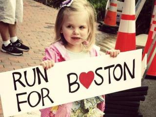 3-year-old Abby Herzog cheers on her Dad in the Tar Heel 10 Miler while remembering victims in Boston. Submitted by Jill Herzog