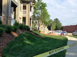 Police investigate a death at the Allister North Hills Apartments complex in north Raleigh on May 15, 2013.