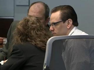 Raven Abaroa listens as his attorneys consult with one another during the cross-examination of a witness in his first-degree murder trial on May 15, 2013.