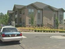 Police spent Wednesday searching for clues in the Allister Drive apartment where a woman was found dead a day earlier.