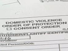 Domestic violence order barred woman from home