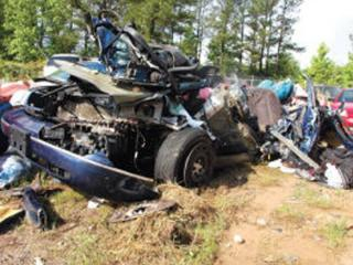 Marianne Karth's care was hit from behind by a tractor-trailer on Interstate 20 in Georgia on May 4 and wound up wedged under another truck. Two of Karth's daughters were killed in the wreck. (Photo courtesy of Billy W. Hobbs, Lake Oconee News)