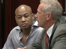 Grant Hayes sits in a Wake County courtroom on May 20, 2013, with his defense attorney, Jeff Cutler.