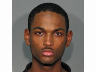 Travian Devonte Smith, 20, is one of three people charged in the death of Melissa Huggins-Jones, who was found covered in blood May 14 inside her North Hills apartment.