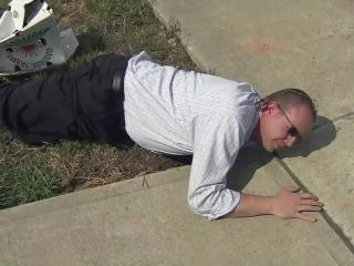 Chris Ertel can reach all the way under this driveway into a hole that has him worried the sidewalk will sink.