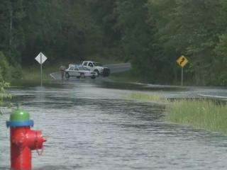 High water in Moore County displaced residents and closed roads Saturday.