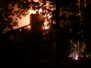 A fire burns at a town house in Cary.