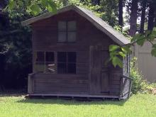 Police: Children forced to stay in backyard playhouse