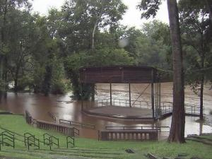 A swollen Cape Fear River overwhelmed the pylons at the Campbellton Boat Landing on July 2, 2013, and lapped at the stage of the nearby amphitheater.