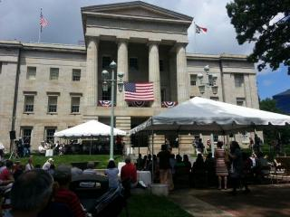 New citizens are sworn in during a naturalization ceremony in front of the old State Capitol on July 4, 2013.