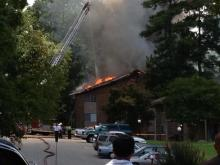 Firefighters battle a blaze at Royal Oaks Apartments in southwest Durham on July 8, 2013.
