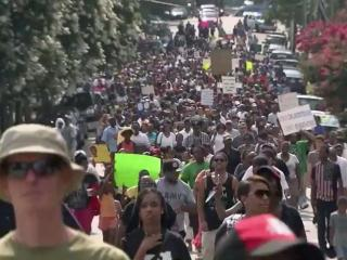 """In the wake of George Zimmerman's acquittal in the death of Trayvon Martin, hundreds of people rallied in downtown Raleigh on July 21, 2013,  for the repeal of """"Stand Your Ground"""" laws."""