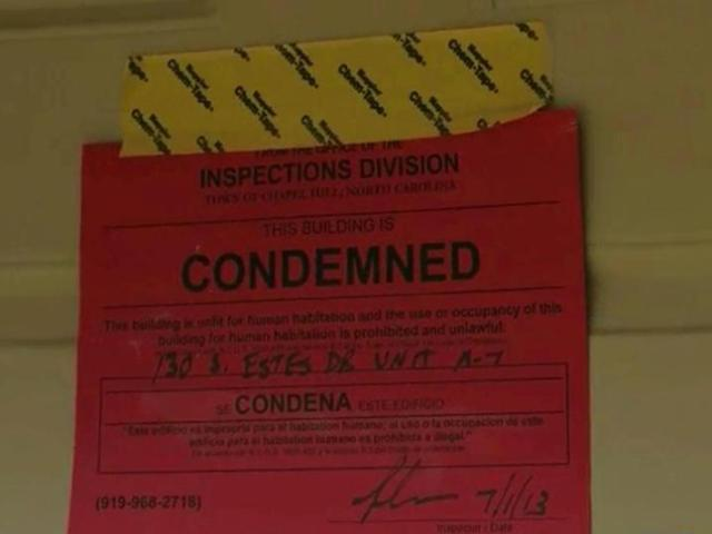 Units at Camelot Village Condominiums are condemned following flooding in Chapel Hill on June 30, 2013.