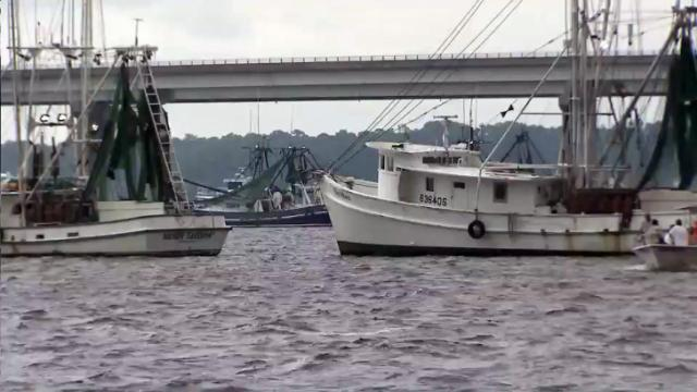 Dozens of fishing trawlers anchored along the riverfront in New Bern on July 30, 2013, in opposition to a petition before the state Marine Fisheries Commission that could end shrimping in coastal waters.