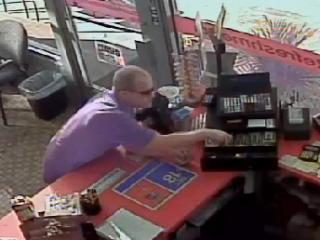 This image from security video shows a man stealing from the cash register at an Exxon on Cary on July 26. Police are asking for the public's help in finding him.