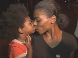Latara Robinson gives her son, Zy'ion McCallum, a kiss after they were reunited early Monday at police headquarters in Durham. The boy was found after missing for more than 24 hours.