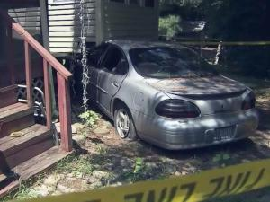 A Pontiac Grand Prix remains lodged in the side of a Coats house weeks after it slammed into the home on July 4, 2013.
