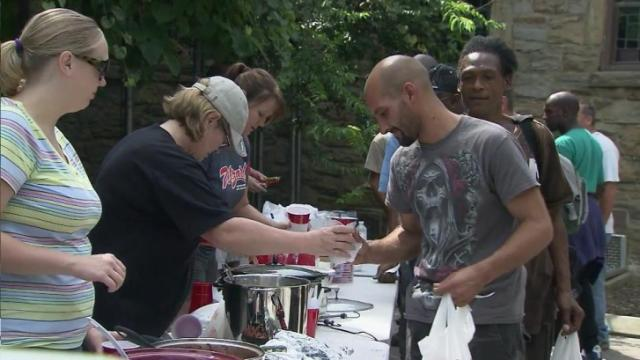 Volunteers distribute food to people near Moore Square in downtown Raleigh on Aug. 25, 2013.