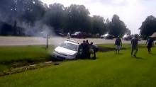IMAGE: Bystanders rescue Johnston officer from burning patrol car