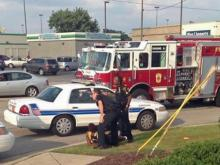 Fayetteville police subdue a woman after she comandeered and crashed a police car.