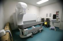 Medical examiners place bodies on this x-ray machine, which can do a full body scan in 13 seconds.