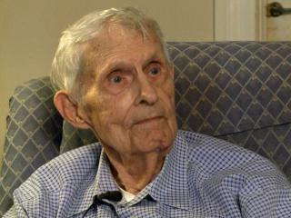Police are looking for a suspect who robbed 88-year-old Victor Spence's home.
