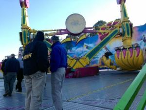 Wake County deputies and state inspectors check the Vortex on Oct. 25, 2013, after five people were injured on the midway ride at the N.C. State Fair.