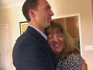 Nathan Rimpf gets a hug from his mom, Cindy Rimpf, who was there to welcome her son into his new home. The custom-built home was donated to Rimpf, an Army Ranger who lost both of his legs in Afghanistan.