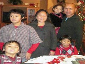 A Wake Forest family gathered anxiously Saturday as they awaited word from their sister in the Philippines.
