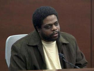 Milton Walker testified on Nov. 15, 2013, during Crystal Mangum's murder trial that she tried to attack him with a knife during a 2010 domestic dispute.