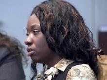 Crystal Mangum listens to testimony in her murder trial on Nov. 18, 2013.