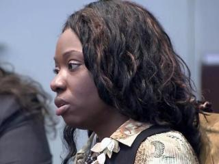 Crystal Mangum listens to testimony in her murder trial on Nov. 18, 2013.