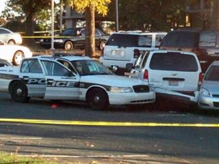 Durham police investigate the death of a 17-year-old near police headquarters early Tuesday, Nov. 19, 2013.