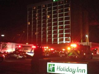 Firefighters and emergency crews respond to the Holiday Inn on Glenwood Avenue in Raleigh after the building's fire alarm activated. Photo taken by Chris Feeney.