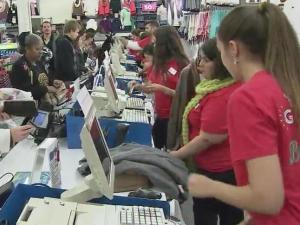 Cashiers ring up purchases at Old Navy in Cary, which opened on Thanksgiving night.