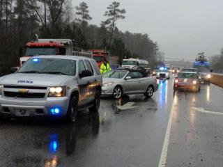 Emergency vehicles set up a road block on N.C. Highway 55 in Apex following a gas line break at Dixie Pipeline Co. on Dec. 9, 2013.