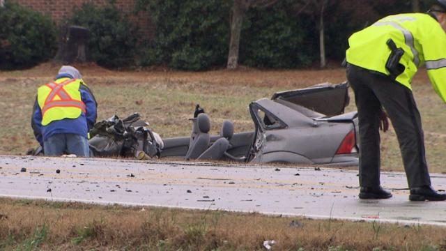Emergency workers were at the scene of a wreck that closed N.C. Highway 42, near Willow Spring, for hours on Dec. 10, 2013.
