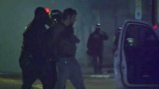 Police arrested those who would not disperse Dec. 19, 2013, in downtown Durham. (Mark Simpson / WRAL)