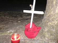 Residents who live on Dana Drive in Raleigh set up a memorial near the site where Elijah Ijah McLendon, 19, died Dec. 22, 2013, after wrecking his scooter. (Beau Minnick/WRAL)